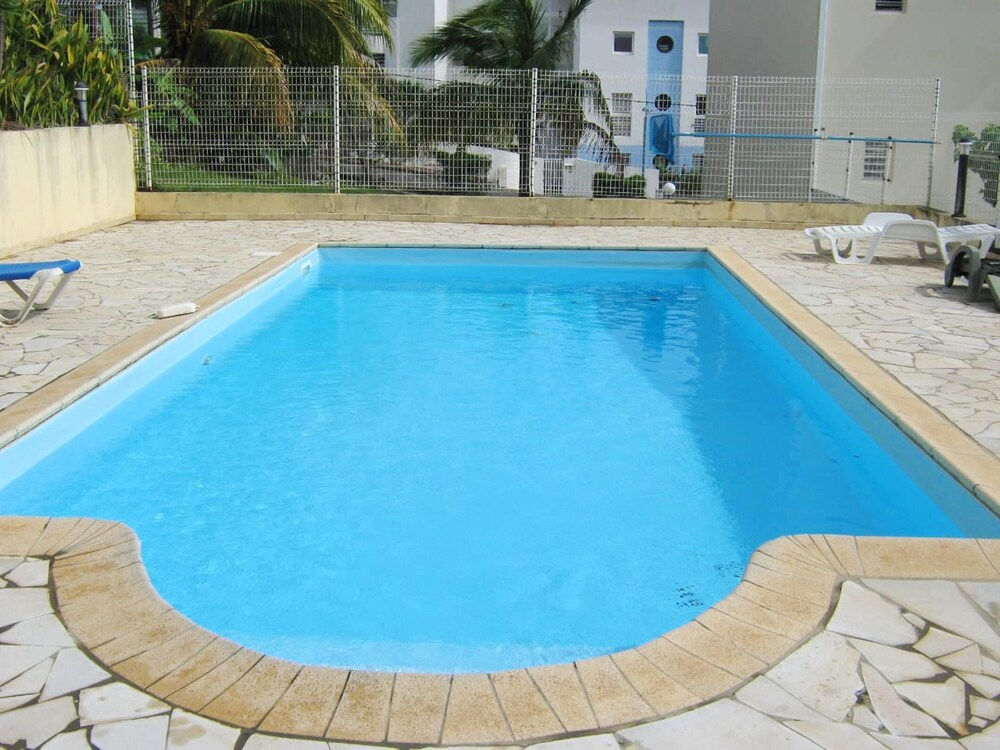 House With one Bedroom in Les Trois îlets With Wonderful sea View Shared Pool Enclosed Garden
