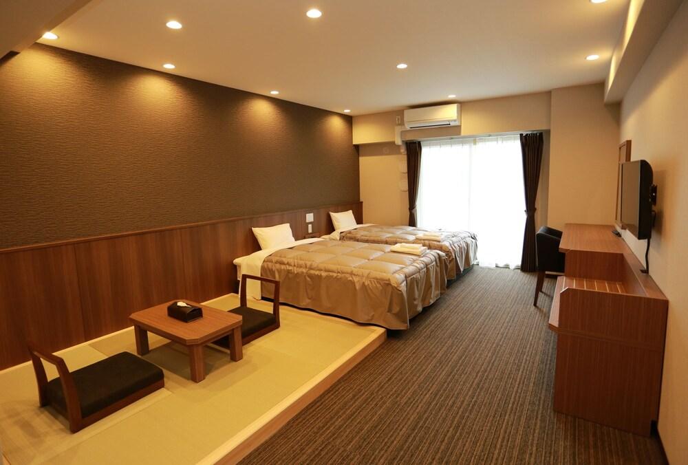 The Base Sakaihigashi Apartment Hotel