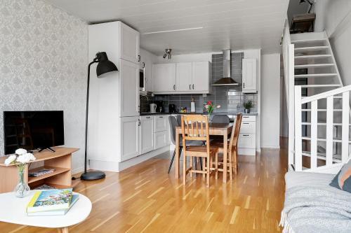 Modern family home in Stockholm Kista master bedroom and loft bedroom