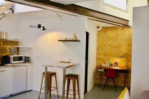Joli studio avec terrasse coeur historique protocole sanitaire strict