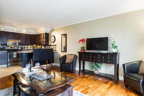 Elegant 1 Bedroom 1 Bath Executive Condo in the Downtown Core Free Heated Underground Parking