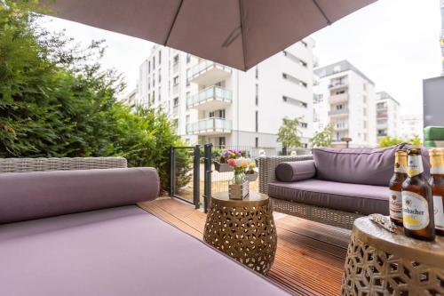 Messe und City Apartment mit 25 m Garten Lounge