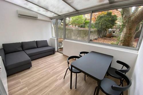Appartement chaleureux avec véranda et jardin au bd Baille